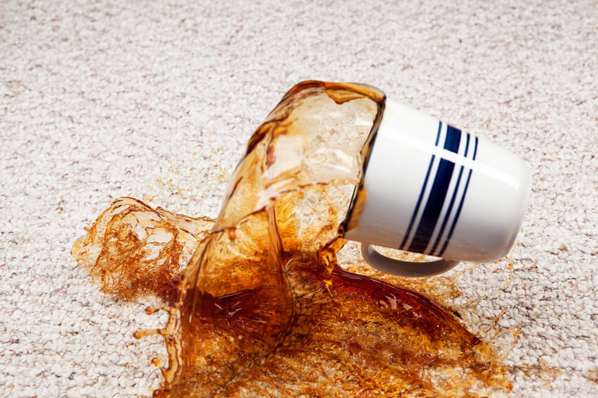 A coffee cup has fallen and coffee is splashing from the cup onto a clean carpet floor. Focus is on the carpet below the cup, at 100% the cup is slightly soft.