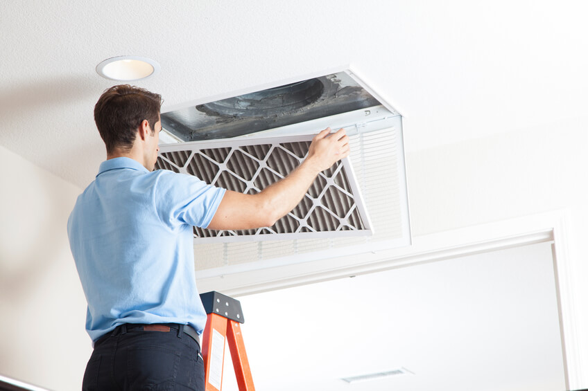 Man cleaning air ducts in home.