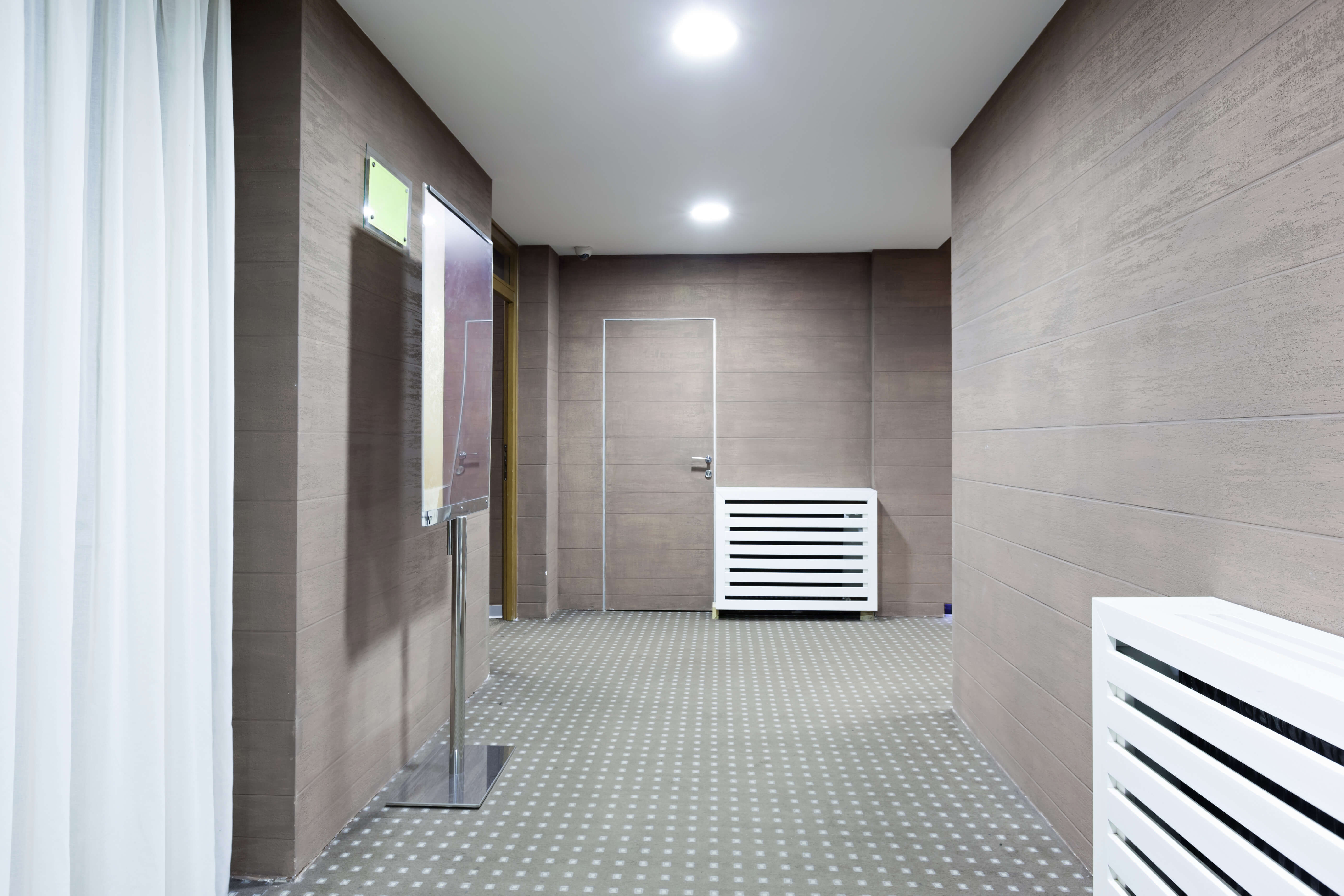 Image of office hallway that could use affordable commercial carpet cleaning Lindon services