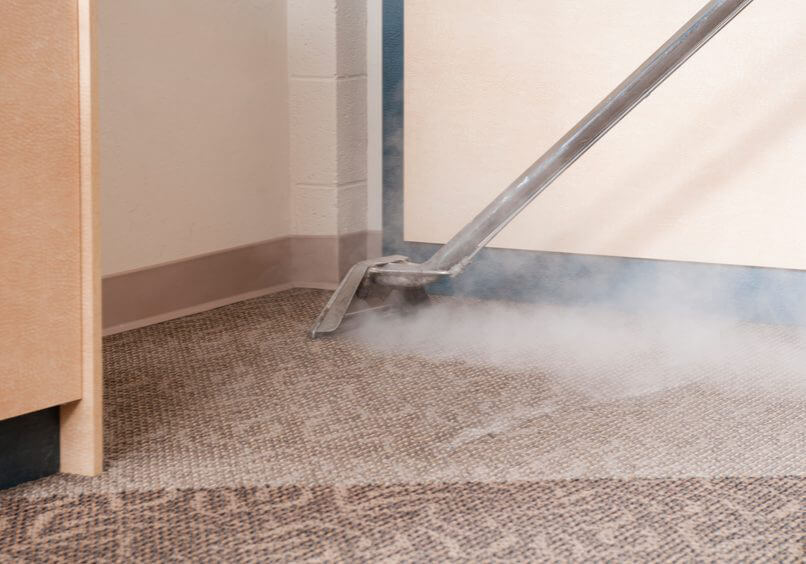 Closeup of steam carpet cleaner at work.Click below for more carpet cleaning plus other commercial cleaning images: