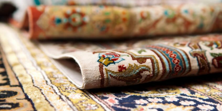 Selective focus image of Persian silk rugs